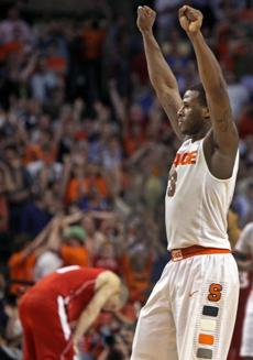 Dion Waiters (13 points) led the celebration after Syracuse downed Wisconsin in an East Regional semifinal at TD Garden.